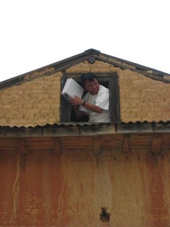 Mahabir fixing the radio