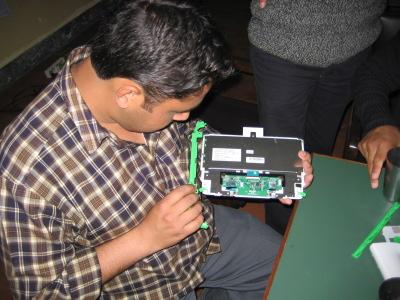 Manoj puts the keyboad back together
