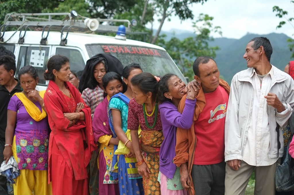 people waiting in line for relief materials