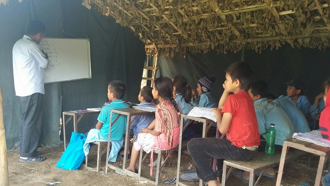 A teacher runs his class in a temporary classrooms.