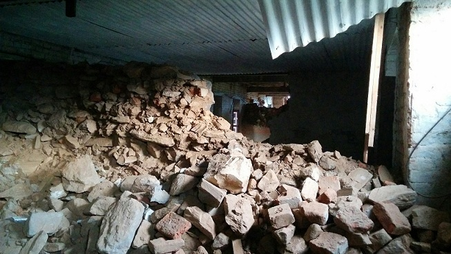 A room fully covered with rubble