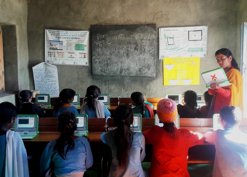 Teacher from Netra Jyoti Primary School, Melauli, teaching her students through E-Paati laptop. According to her, the best part of teaching through E-Paati is that it allows each students to learn at their own pace.
