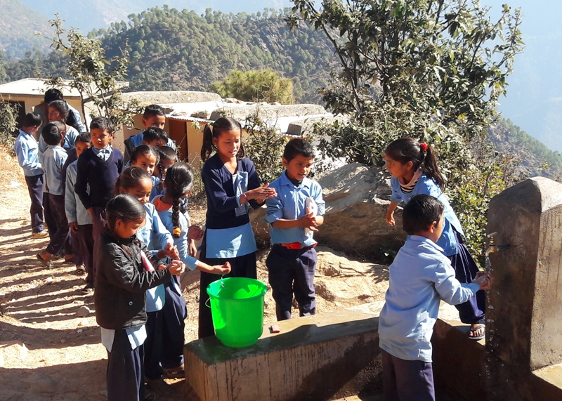 Students at Singapur Primary School, Sungada washing their hands before eating. Along with the School Meal Program, UN World Food Programme is also running WASH Program in most of the schools in far-western districts, including Baitadi.